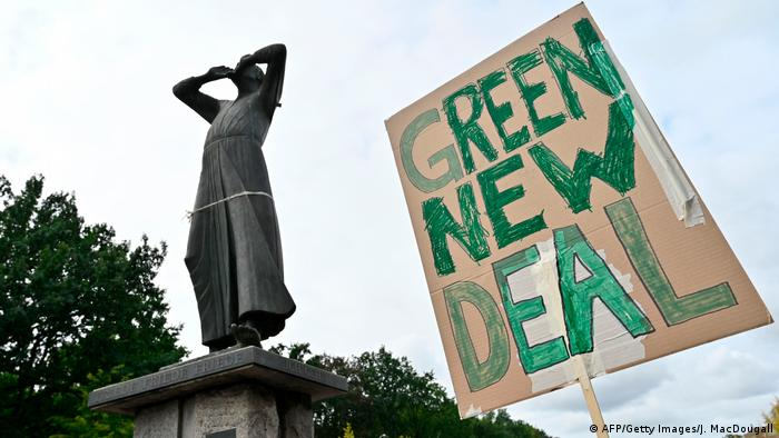 Berlin - A sign reading Green New Deal is held up near the Brandenburg Gate in Berlin as a protest for climate action