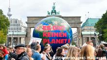 A balloon reads There is no Planet B in front of the Brandenburg Gate in Berlin as a protest for climate action on September 20, 2019, as part of a global climate action day. (Photo by John MACDOUGALL / AFP) (Photo credit should read JOHN MACDOUGALL/AFP/Getty Images)