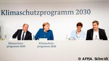 20.09.2019 *** (L to R) German Finance Minister and Vice-Chancellor Olaf Scholz, German Chancellor Angela Merkel and German Defence Minister Annegret Kramp-Karrenbauer and Bavaria's State Premier and leader of the Bavarian Christian Social Union (CSU) Markus Soeder arrive for a press conference after a climate commitee meeting at the Futurium on September 20, 2019 in Berlin. - Chancellor Angela Merkel's government struggles to secure a deal on a broad climate plan for Germany despite overnight talks dragging over 16 hours, as protesters rally in the streets demanding change. (Photo by AXEL SCHMIDT / AFP)