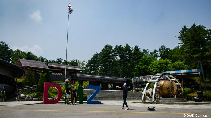 Tourists pose for pictures at the Korean Demilitarized Zone
