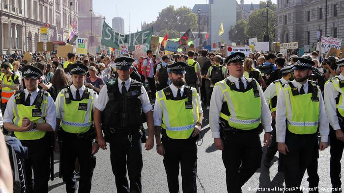 Police at a climate protest in London