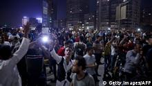 20.09.2019 *** Egyptian protesters shout slogans as they take part in a protest calling for the removal of President Abdel Fattah al-Sisi in Cairo's downtown on September 20, 2019. - Protestors also gathered in other Egyptian cities calling for the removal of President Abdel Fattah al-Sisi but police quickly dispersed them. In Cairo dozens of people joined night-time demonstrations around Tahrir Square -- the epicenter of the 2011 revolution that toppled the country's long-time autocratic leader. (Photo by STR / AFP) (Photo credit should read STR/AFP/Getty Images)