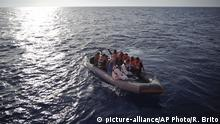 Migrants rescued on a dingy boat in the Mediterranean Sea