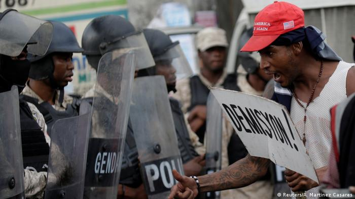 Protesters clash with riot police in Haiti