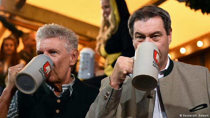 Munich mayor Dieter Reiter (l) and Bavarian State Prime Minister Markus Söder (r) drink beer on the opening day of the 186th Oktoberfest in Munich