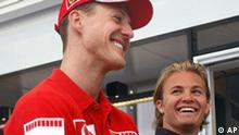 FILE - ALTERNATE CROP - Ferrari driver Michael Schumacher, left, of Germany, and fellow-countryman Nico Rosberg, of Williams, talk at the Dino and Enzo Ferrari racetrack in Imola, Italy, April 20, 2006. Seven-time Formula One champion Michael Schumacher is coming out of retirement to drive for Mercedes in 2010. The 40-year-old German driver, who retired three years ago, confirmed his comeback on Wednesday. Schumacher will partner Nico Rosberg in an all-German team for the 2010 season. (AP Photo/Luca Bruno)