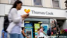 A sign is pictured above a branch of a Thomas Cook travel agent's shop in London on July 12, 2019. - China's Fosun Group is considering nearly a billion dollar rescue of embattled British tour operator Thomas Cook, the Hong Kong-listed conglomerate confirmed Friday. The Chinese company said in a stock market announcement that there are ongoing advanced discussions about a capital injection which would see a debt-for-equity swap at the British travel agency, which has struggled with its debt pile. (Photo by Tolga Akmen / various sources / AFP) (Photo credit should read TOLGA AKMEN/AFP/Getty Images)