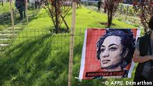 People walk through the ' Jardin Marielle Franco' a public garden close to Gare de l'Est train station in northern Paris, following an inauguration ceremony attended by her family members and French officials on September 21, 2019. - Brazilian politician, feminist, and human rights activist Marielle Franco was shot to death on March 14, 2018, by two gun wielding assailants north of Rio de Janeiro in Brazil. Her murder came the day after she spoke out against police violence in Rio. In March 2019, two former members of the Brazilian military police force were arrested and charged with the murder of Marielle Franco. (Photo by JACQUES DEMARTHON / AFP)