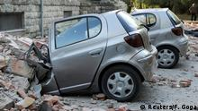 Cars crushed by rubble in Tirana