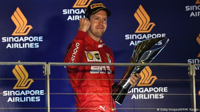 Ferrari's German driver Sebastian Vettel celebrates his victory on the podium after the Formula One Singapore Grand Prix