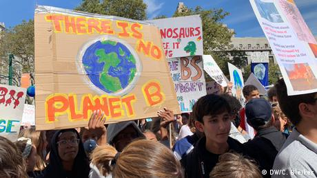 School students protest for the climate, holding a sign that reads 'There is no Planet B'