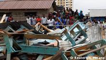 Kenyan people gather at the site of a collapsed school classroom, in Nairobi, Kenya, September 23, 2019. REUTERS/Njeri Mwangi