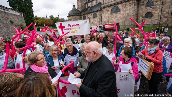Cardinal Reinhard Marx speaks with demonstrators from the Catholic Women's Community of Germany (kfd) in Fulda