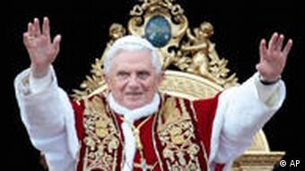 Pope Benedict XVI gestures to faithful