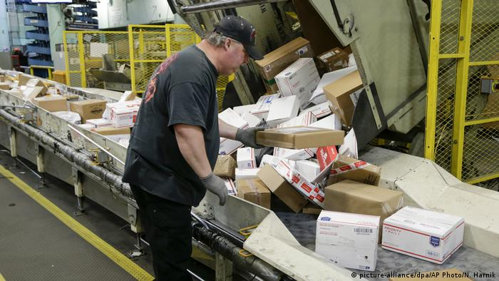 A US Postal Service sorting packages