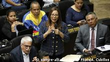 Lawmakers Tania Diaz of the Venezuelan Socialist United Party speaks during a National Assembly session in Caracas, Venezuela, Tuesday, Sept. 24, 2019. Lawmakers with the ruling socialist party returning to the National Assembly Tuesday after years of absence as part of a widely criticized pact between President Nicolas Maduro and a handful of outlier opposition parties. Opposition leader Juan Guaido is the legislature's president and has lambasted the accord. (AP Photo/Ariana Cubillos) |