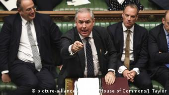 Attorney General Geoffrey Cox points during a parliament session