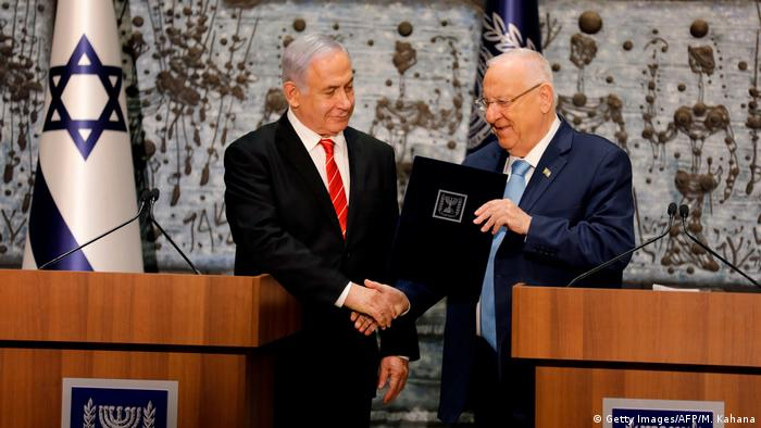 Israel's Netanyahu shakes hands with President Rivlin