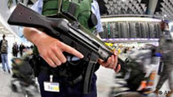 An armed German federal police officer is seen in the terminal of the International Airport of Frankfurt