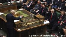 """In this handout photo provided by the House of Commons, Britain's Prime Minister Boris Johnson, left, speaks in Parliament in London, Wednesday, Sept. 25, 2019. An unrepentant Prime Minister Boris Johnson brushed off cries of """"Resign!"""" and dared the political opposition to try to topple him Wednesday at a raucous session of Parliament, a day after Britain's highest court ruled he acted illegally in suspending the body ahead of the Brexit deadline. (Jessica Taylor/House of Commons via AP) 