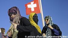 Schweiz Burka- und Kopftuchträgerinnen
