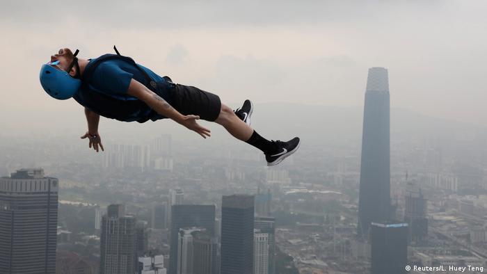 BdtD BASE jumper Kuala Lumpur Tower (Reuters/L. Huey Teng)