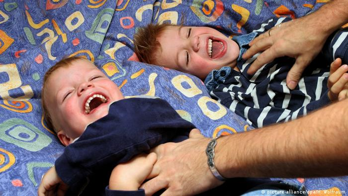 Two children being tickled