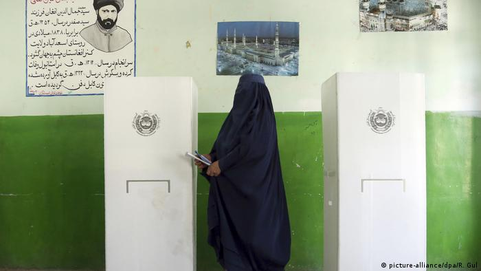 A woman voting at an Afghan polling station