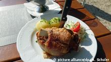 Traditionelle deutsche Küche - Gegrillte Schweinehaxe