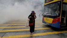 29.09.2019 *** A woman walks near tear gas during a protest in Hong Kong on Sunday, Sept. 29, 2019. Sunday's gathering of protesters, a continuation of monthslong protests for greater democracy, is part of global anti-totalitarianism rallies planned in over 60 cities worldwide to denounce Chinese tyranny. (AP Photo/Kin Cheung) |