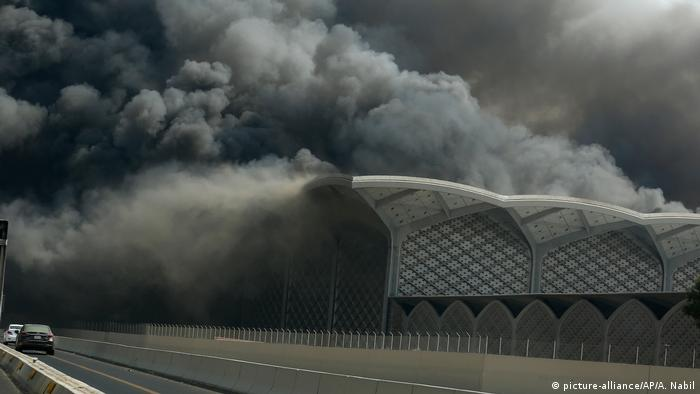 Thick smoke rises from a fire at a train station in Jeddah, Saudi Arabia