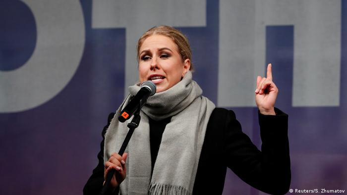 Sobol points up while giving a speech to protesters in Moscow in 2019
