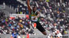 Burkina Faso's Hugues Fabrice Zango competes in the Men's Triple Jump final at the 2019 IAAF World Athletics Championships at the Khalifa International Stadium in Doha on September 29, 2019. (Photo by ANDREJ ISAKOVIC / AFP)