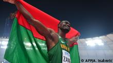 Third placed Burkina Faso's Hugues Fabrice Zango celebrates after the Men's Triple Jump final at the 2019 IAAF World Athletics Championships at the Khalifa International Stadium in Doha on September 29, 2019. (Photo by ANDREJ ISAKOVIC / AFP)