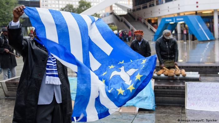 A man waving the flag of 'Ambazonia'