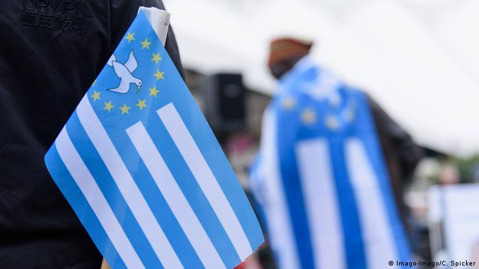 Ambazonia flags at a demonstration in Berlin (Imago-Imago/C. Spicker)