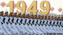 Soldiers of People's Liberation Army (PLA) march in formation past Tiananmen Square during a rehearsal before a military parade marking the 70th founding anniversary of People's Republic of China, on its National Day in Beijing, China October 1, 2019. REUTERS/Thomas Peter