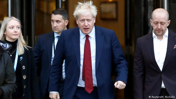 Britain's Prime Minister Boris Johnson is seen outside the venue for the Conservative Party conference