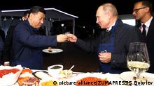 September 12, 2018 - Vladivostok, Russia - Russian President Vladimir Putin toasts Chinese President Xi Jinping with Russian vodka at an exhibition during the Eastern Economic Forum at the Far Eastern Federal University September 11, 2018 in Vladivostok, Russia |