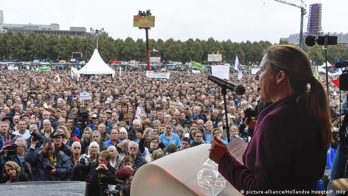 A speaker at the podium addresses a large demonstration at Malieveld in The Hague against forced shrinking of livestock and for a clearer long-term agricultural policy. October 1, 2019.
