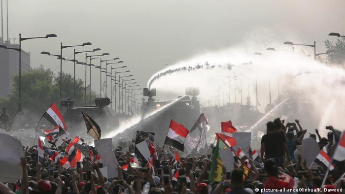 Water cannons are used to disperse the protest in Baghdad