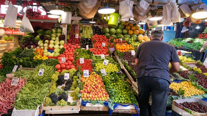A man at a produce stand in Turkey