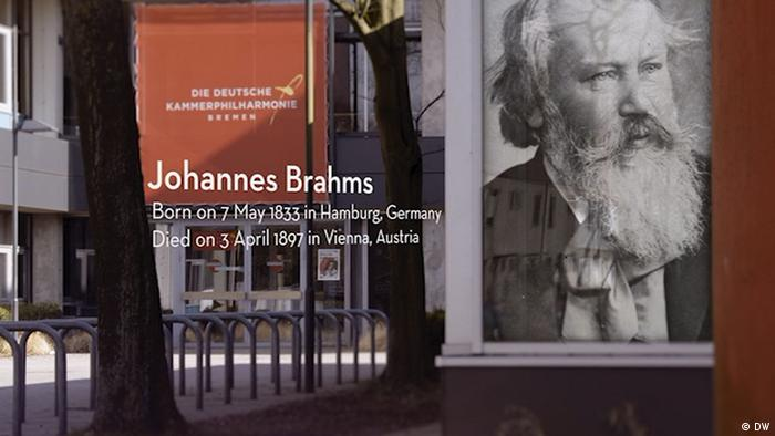Poster of the bearded old Brahms with his birth and death dates (DW)