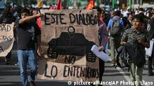 Demonstrators carry a sign with a military tank and the Spanish message This dialogue we don't understand, during a march in remembrance of the Tlatelolco student massacre in Mexico City, Wednesday, Oct. 2, 2019. Mexico commemorated the 51st anniversary of the 1968 massacre where students and civilians were killed by the military and police. (AP Photo/Fernando Llano)  