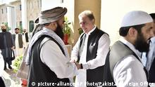 In this photo released by the Foreign Office, Pakistan's Foreign Minister Shah Mehmood Qureshi, center, receives members of Taliban delegation at the Foreign Office in Islamabad, Pakistan, Thursday, Oct. 3, 2019. Senior Taliban leaders are meeting with Qureshi in Islamabad as part of a push to revive an Afghanistan peace deal that has included stops in Russia, China and Iran. (Pakistan Foreign Office via AP) |