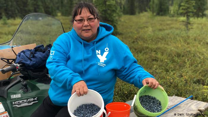 Alaska Native Teresa Hunter shows her blueberry harvest