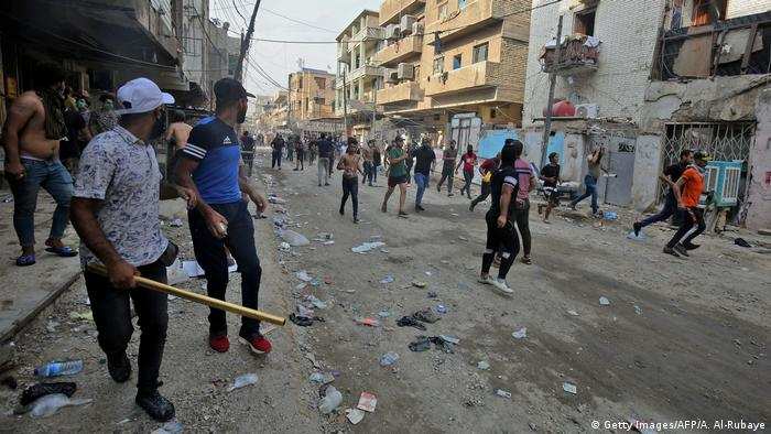 Protesters fleeing from police firing tear gas and live rounds near Tahrir Square, Baghdad