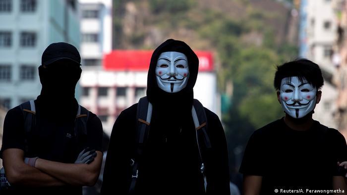 Hong Kong protesters wearing Guy Fawkes masks