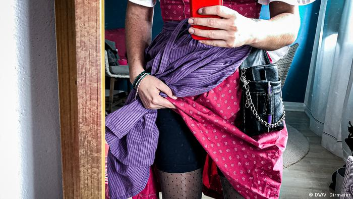 A woman in a dirndl shows off the cycling shorts underneath