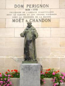 In this photo taken Tuesday, Sept. 23, 2008, a view of the entrance to Moet & Chandon headquarters is seen, in Epernay, eastern France, with a statue of Dom Perignon, the monk credited with the invention of champagne in the seventeenth century. Champagne sales fell 2.6 percent in the first eight months of the year to 165 million bottles, according to figures from Champagne wine growers committee CIVC. Domestic sales were down 4.2 percent to 89 million bottles, while exports fell 0.67 percent to 76 million bottles. (AP Photo/Emma Evandore, File)